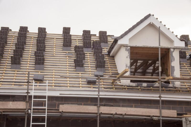 Stacked Shingles on a roof getting prepped to have the men start laying shingles down For Delaware County Roofers